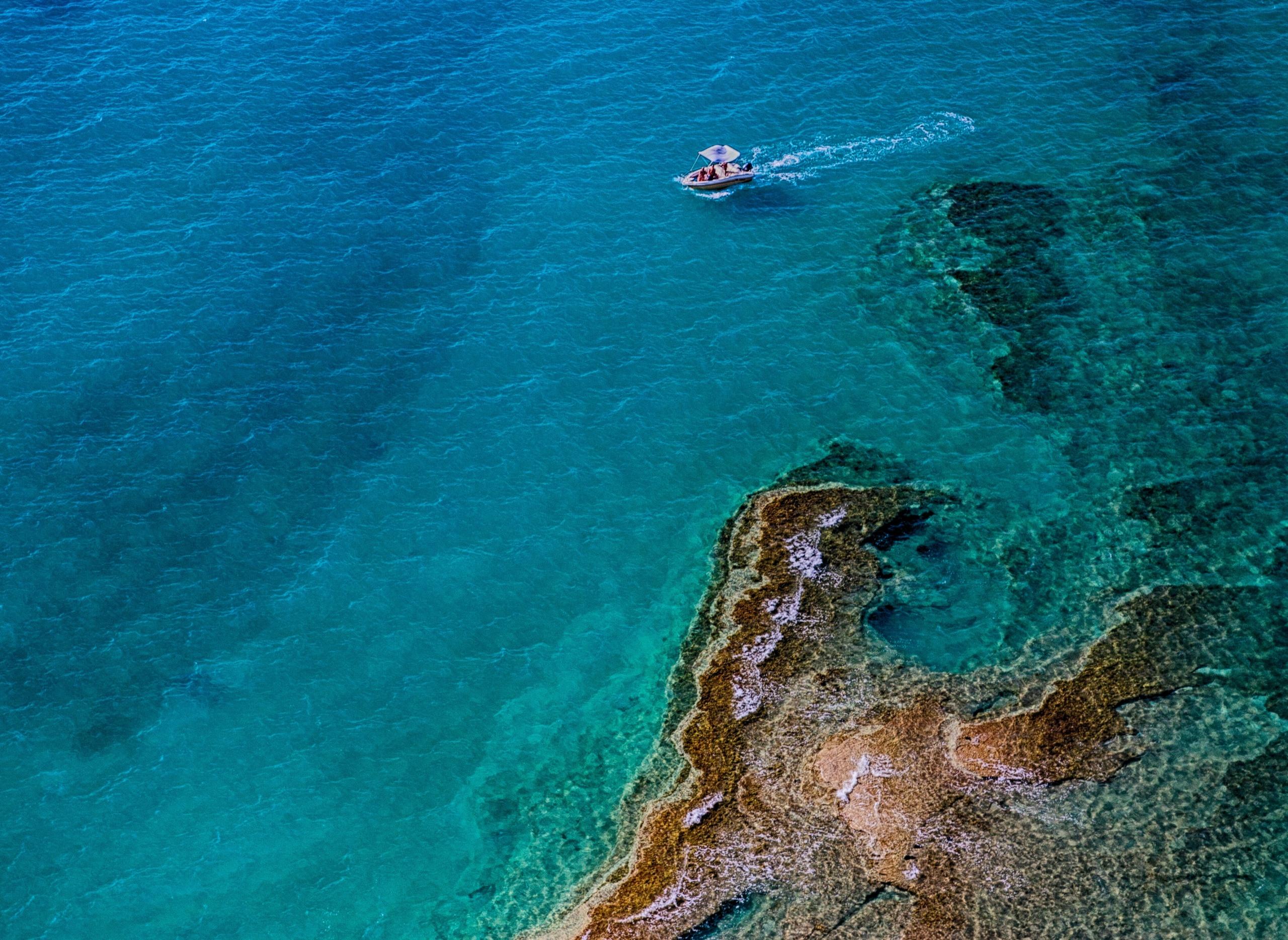 an-corfu-destination- sea ambiance - blue tirquise waters dawid-zawila-EX3n8Vsj2og-unsplash